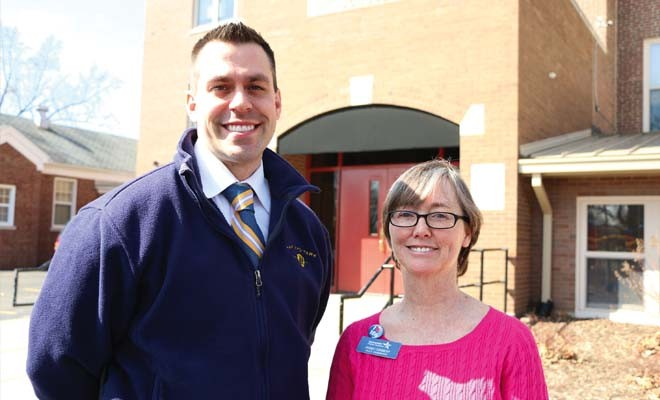 James Hayes, Harvard Park Elementary principal, and Peggy Cormeny, family and community engagement coordinator for Springfield Public Schools, appear outside the school, which recently hosted an event helping families enroll in health insurance. - PHOTO BY PATRICK YEAGLE