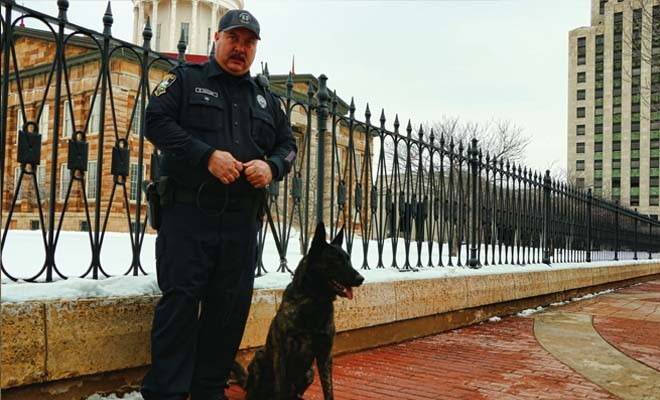 Springfield patrol officer Ron Howard is head of the Springfield Police Department's drug dog unit. He's shown here with his dog, Jax. - PHOTO BY PATRICK YEAGLE