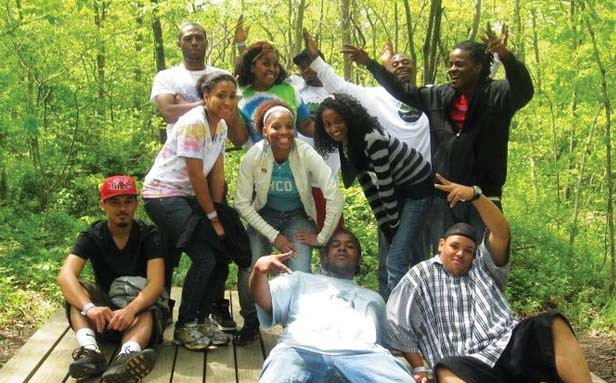 Participants in the Springfield Urban League's recent Afia Empowerment Retreat enjoy some down time. During the retreat, which was held at Carlinville's Lake Williamson, the young women took part in the SISTA Project, while the young men participated in t - COURTESY SPRINGFIELD URBAN LEAGUE