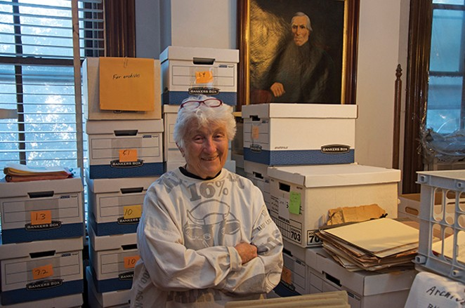 Jackson with some of her life's work boxed to go to a university archive. - PHOTO BY GINNY LEE