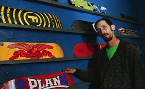 Colin Eigenmann amid his wares at Boof City Skate Shop. - PHOTOS BY PATRICK YEAGLE