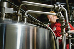 A brewer at Schlafly Bottleworks checks on a batch of its Pale Ale in Maplewood, MO. - PHOTO BY HUY RICHARD MACH/TNS