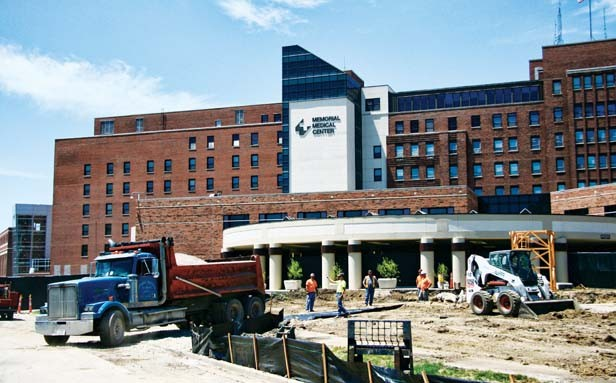 A construction crew prepares to pour a large concrete pad that will support a tall construction crane in the coming weeks at Memorial Medical Center's main entrance facing south. - PHOTO BY PATRICK YEAGLE
