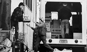 Barry Locher, then a State Journal-Register photographer, snapped this shot of volunteers loading up donations at a local market in 1979. - PHOTOS COURTESY OF THE SANGAMON VALLEY COLLECTION.