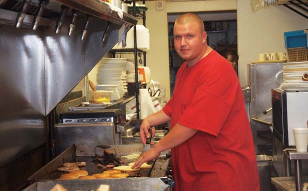 Justin Smith has been a cook at Debbie's Diner for the past two years under the state's work-release program. - PHOTO BY GINNY LEE