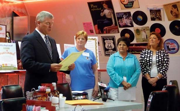 """Illinois Times publisher Sharon Whalen, second from left, as the late Mayor Tim Davlin proclaims """"Independents Week"""" for the Capital Area Independent Business Association in July 2009. At right are Rosemarie Long and Debbie Cimaros"""