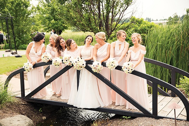 Sarah Raftis and her bridesmaids at Metamora Fields golf club in Metamora. - PHOTO BY MATT DEBACKERE PHOTOGRAPHY