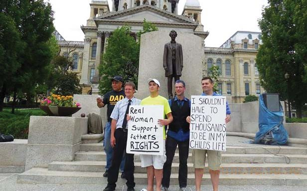Left to right are Captain Tony Taylor, fathers rights activist from Chicago; Steven Westerfield, Illinois Fathers area coordinator from Springfield; Shane Bouvet, Illinois Fathers member from Taylorville; Todd Bottom, a doctoral student at DePaul Universi - PHOTO PROVIDED BY ILLINOIS FATHERS