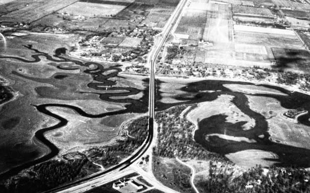 An aerial photo taken by 1954 CWLP employee Chuck Laswell shows Old Sugar and Lick creeks cross the dry bed of drought-ravaged Lake Springfield. - PHOTO COURTESY THE SANGAMON VALLEY COLLECTION AT LINCOLN LIBRARY.