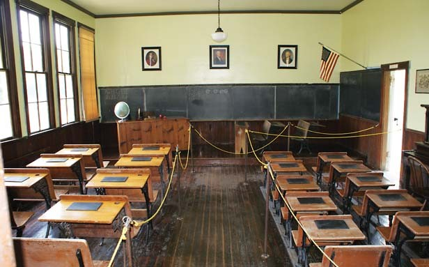 The East Prairie school, a one-room schoolhouse that was attended by Old Order Amish as well as non-Amish children prior to its closing in 1966. It was moved to Rockome Gardens in 1968. - PHOTO BY KEITH LADAGE