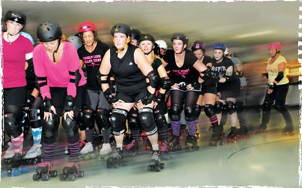 """This is the """"pack."""" A """"jammer"""" has to skate through the pack in order to score points. - PHOTO BY TREVOR MILLER"""