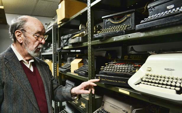 Ben Bushnell, 82-year-old owner of Royal Office Equipment in Springfield, looks over his inventory of antique typewriters. - PHOTO BY JACQUELINE MUHAMMAD