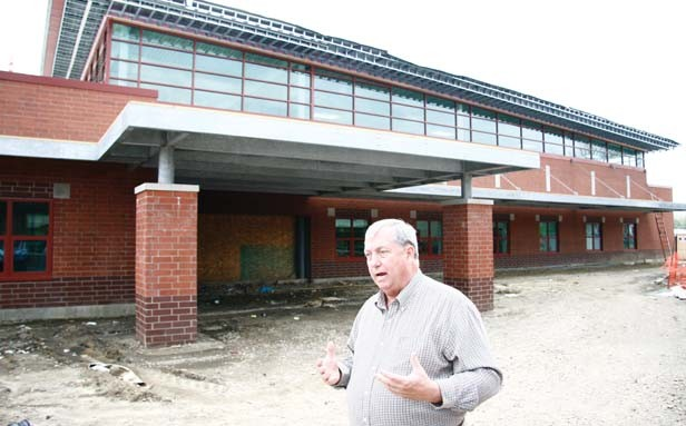 Dave Smith, director of operations and maintenance for School District 186, leads a tour of the new Matheny-Withrow Elementary School, which features a community room. - PHOTO BY PATRICK YEAGLE