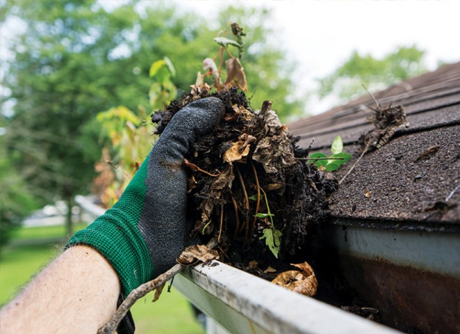 Cleaning gutters and downspouts helps prevent basement moisture and seepage. - PHOTO BY ISTOCKPHOTO.COM