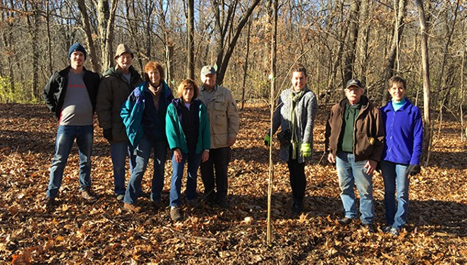 Members of the Springfield South, Sunrise and Midtown Rotary Clubs planted trees at Lincoln Memorial Garden in December.  Larry Miller,  Lincoln Memorial Garden head gardener, is second from right.