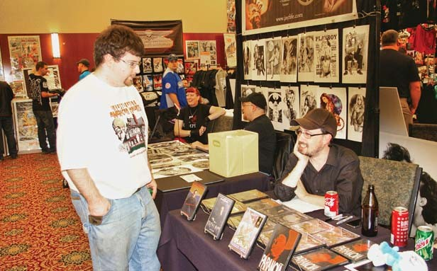 Brad Jones, aka The Cinema Snob, hawks DVDs and chats with fans during a recent horror-movie convention in Indianapolis. - PHOTO BY BRUCE RUSHTON
