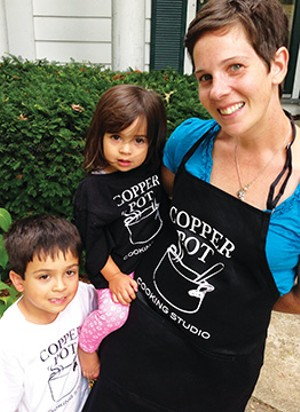Ben, left, and Norah Perry with their mom, Chef Denise Perry. Her new cooking school features classes for children, as well as for adults.