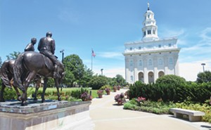 The exterior of the Nauvoo Temple is a replica of the original temple that was burned and destroyed.  Nearby is a sculpture depicting Joseph and Hyrum Smith's last ride to Carthage. - PHOTOS BY JOHN CAMPER