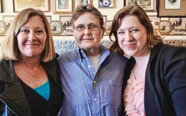 Peggy Jo Jackson, center, celebrates her release from prison after nearly 26 years. Also pictured are Rhonda Keech (left), case coordinator, and Erica Nichols Cook (right), staff attorney. Both work for the Illinois Innocence Project. - PHOTO BY MANDY ALTMAN