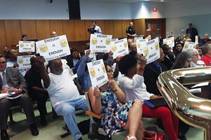 Residents angry and surprised by a proposal that would put a homeless shelter in their neighborhood filled city council chambers last month.