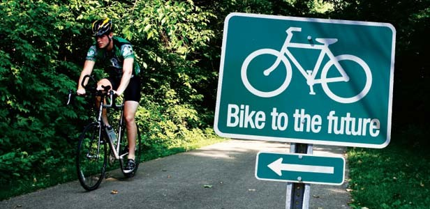 A cyclist enjoys the Lost Bridge Trail connecting Springfield and Rochester. - PHOTO BY PATRICK YEAGLE