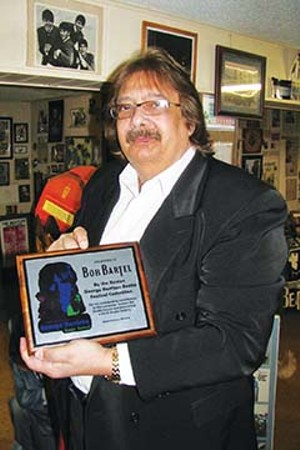 """Uber Beatle fan and music historian Bob Bartel of Springfield was instrumental in saving the """"Beatle House"""" in Benton from the wrecking ball in 1995. He since has produced a video documentary (A Beatle in Benton), which has been tr - PHOTO BY WILLIAM FURRY"""