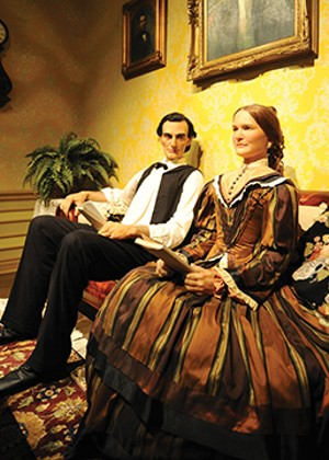 """Visitors to the Abraham Lincoln Presidential Museum see Abraham and Mary during their courtship. The original """"courting couch"""" is now on display at Edwards Place. - PHOTO COURTESY OF ABRAHAM LINCOLN PRESIDENTIAL MUSEUM"""