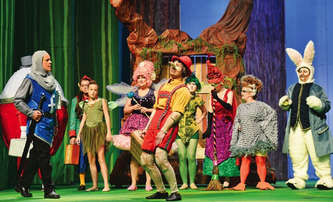 Pinocchio (Luke Petersen, center) performs, surrounded by other fairytale creatures. - PHOTO BY DONNA LOUNSBERRY