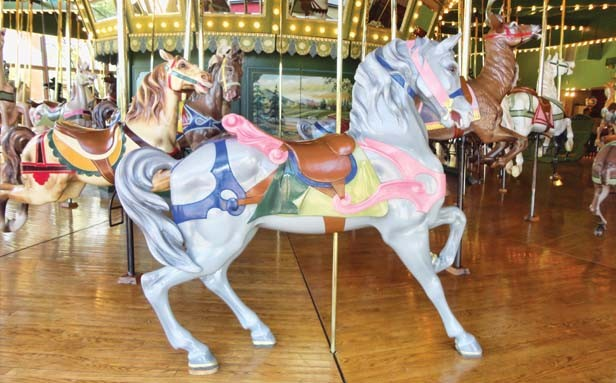 The St. Louis Carousel, built in 1920, is still operating, at $2 a ride. - PHOTO BY CINDY LADAGE