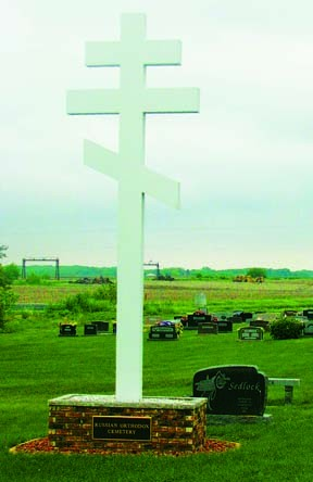 Although the Russian Orthodox Church in Streator closed nearly 100 years ago, the old city cemetery still receives Orthodox burials. The three-barred cross has been a symbol of the Russian Orthodox Church for centuries. The bar at the top symbolizes the s