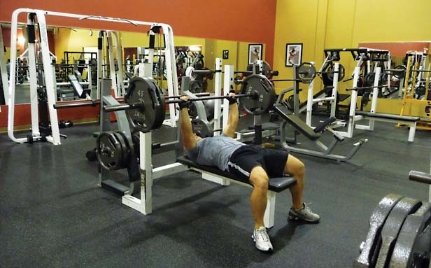 Weight lifting is just one offering at FitClub, which has three clubs in Springfield and wants to build a fourth in Chatham. - PHOTO BY PATRICK YEAGLE