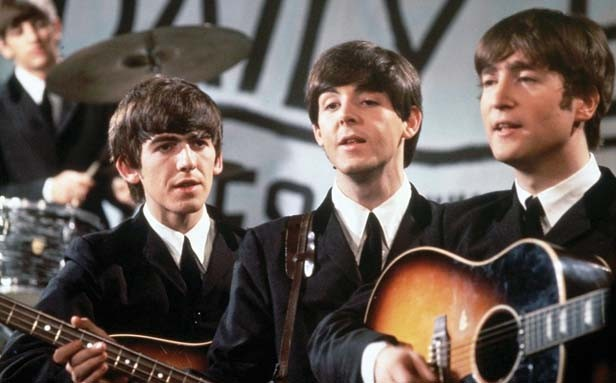 The clean cut, mop-top quartet in 1964 (l-r: George, Paul and John, with Ringo on the drums in the rear) when their music was topping record charts around the world.