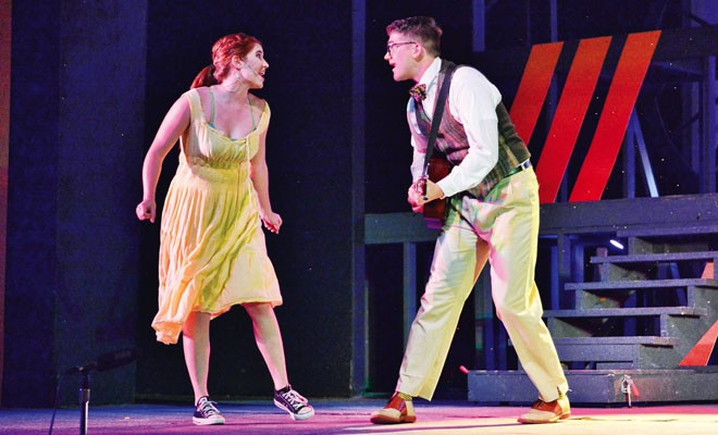 Natalie (Sophie Lanser) and Dennis (Jacob Deters) perform a duet. - PHOTO BY DONNA LOUNSBERRY