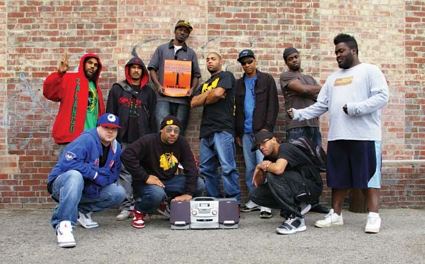 """Performers, left to right: Tebe Zalango, MC R-Two, DJKT, Rikashay (holding the sign), Howard """"Torch"""" Tomas, Bis, Rashid, Boby Fishr, Mr. Myles and Cornbread. - PHOTO BY DAVID HINE"""
