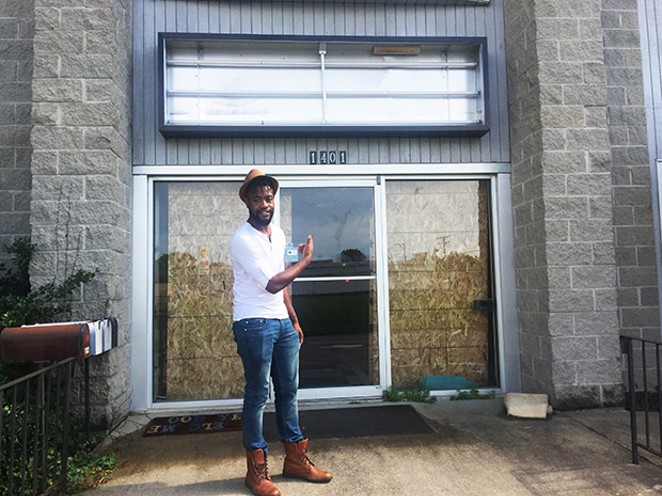 Ayo Abitogun of HISO Music at the entrance of his new space. - PHOTO BY SCOTT FAINGOLD