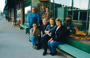 Village residents found downtown on a recent afternoon include business owners Peter Neihaus, Bill and Kathy Cosby (standing); artist Renee Sisk, business owner Andrea Neihaus, historian Gillette Ransom, and Linda Gleason (seated).