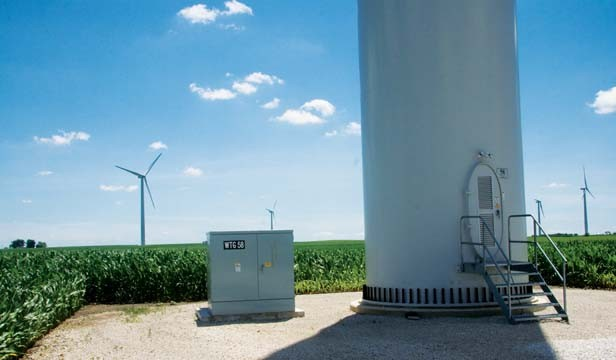 The base of a wind turbine near Hopedale, Ill., sits next to an electrical transformer on a small plot leased from rural landowners.  About 200 such turbines could be erected in Sangamon County as early as 2012. - PHOTO BY PATRICK YEAGLE