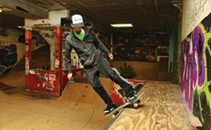 Quick and dirty ramp action inside Skank Skates International. - PHOTOS BY PATRICK YEAGLE
