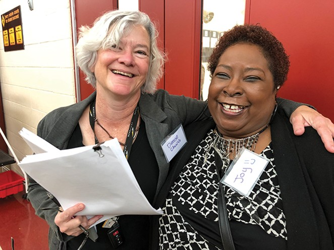 """Joy Burgess, right, chief organizer of the expungement summit, works at the Land of Lincoln Legal Assistance Foundation, but also did it as a labor of love. """"Oh my God it feels good to be able to help people,"""" she said. Denise Church, left, a - PHOTO BY FLETCHER FARRAR"""
