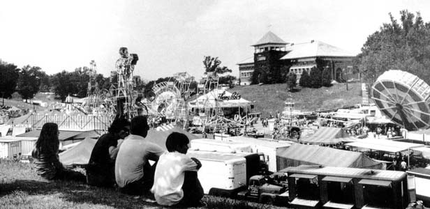 In the 1960s a family rests on the knoll overlooking Happy Hollow, former home of the fair's carnival midway. - PHOTOS COURTESY OF SANGAMON VALLEY COLLECTION