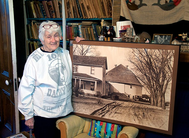 Jackie Jackson, at home on Fifth Street in Springfield, with her former home in Wisconsin, the subject of her recently completed magnum opus. - PHOTO BY GINNY LEE