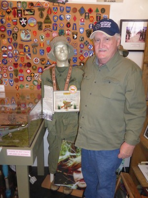 David Estes shows the fatigues he wore in Vietnam on one of 250 mannequins displaying military uniforms at the Livingston County War Museum in Pontiac. David's father, Dal, began the museum with his own collection of military memorabilia in 2004, a - MARY BOHLEN