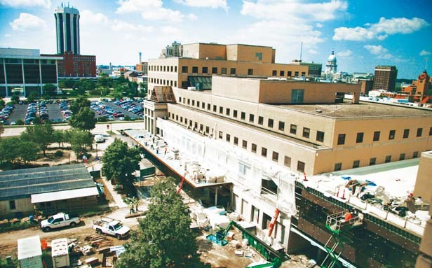 A construction crew works on the exterior of the new surgical wing at St. John's Hospital. This photo was taken from the eighth floor of the patient tower facing south toward Madison Street. - PHOTO BY PATRICK YEAGLE