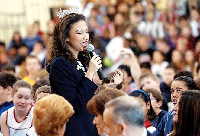 Erika Harold speaks at Margaret Mead Jr. High School in Elk Grove Village while reigning as Miss America in 2003. - PHOTO BY GEORGE THOMPSON/TNS)