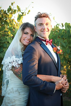 Molly Suhadolnik and Tim Hahn of Springfield, married Sept. 30 at Hill Prairie Winery. - PHOTO BY KATE BLANKENSHIP OF THIS BLUE DOG PHOTOGRAPHY
