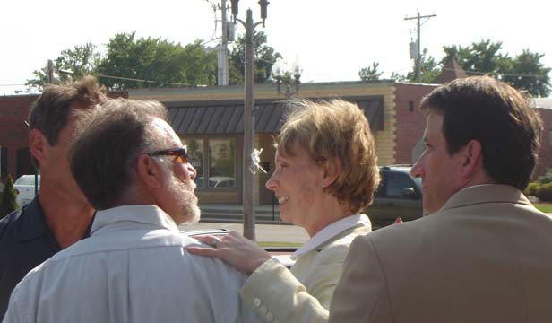Julie Rea Harper embraces UIS professor Larry Golden (left) outside the courthouse. Golden, co-founder of the Downstate Illinois Innocence Project, helped in the initial research on Harper's case.