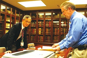 Papers project director Daniel Stowell, right, studies documents during a 2012 trip to Mesei University in Japan, which holds the largest known collection of Lincoln documents outside the United States. - PHOTO COURTESY OF THE PAPERS OF ABRAHAM LINCOLN