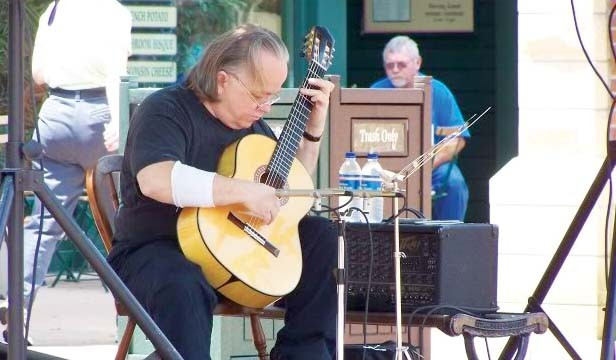 Classical guitarist Russel Brazzel, pictured here performing downtown at an Artist on the Plaza event, will perform at the Springfield Classical Guitar Society on Oct. 16 at 8pm. - PHOTO COURTESY PHOTOS-ETC.BLOGSPOT.COM
