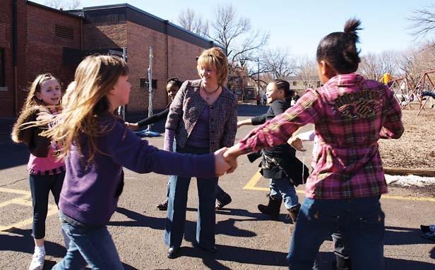 Counterclockwise from left, Hannah Myers, Skye Palmer, Bria Price, Sakoyia Wrenn and Bryannah Kittrell surround McClernand Elementary School Principal Jennifer Gill. - PHOTO BY DAVID HINE