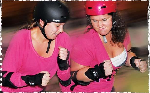 Mia Madness, aka Maria Hillen, and NAG EM, aka Megan R. Martin, practicing the shoulder block. - PHOTO BY TREVOR MILLER